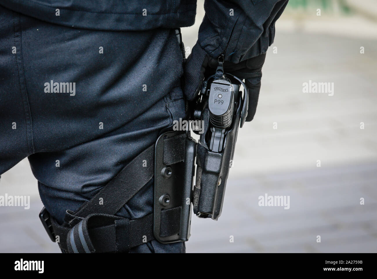 03.05.2019, Essen, North Rhine-Westphalia, Germany - Hand on the service weapon Walther P99, policeman in action at Fridays for Future Demonstration o Stock Photo