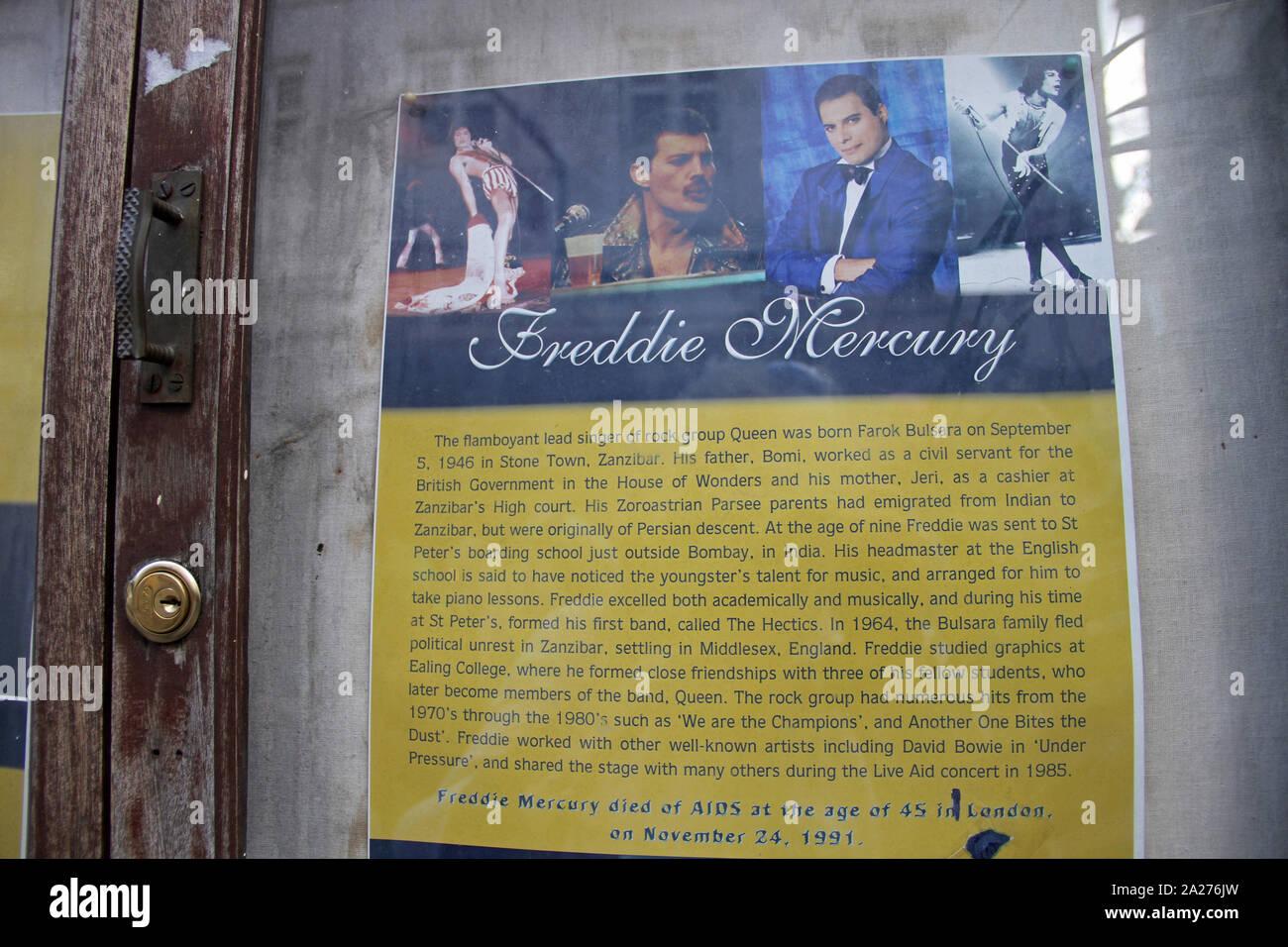 Historical and bibliographical poster of Freddie Mercury encased in glass inside the Mercury House Museum, Stone Town, Zanzibar, Unguja Island, Tanzania. Stock Photo