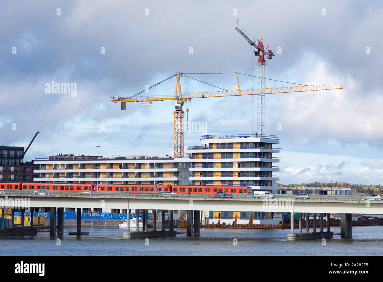 Construction proceeds actively at the new Kalasatama business and residential area of Helsinki, Finland. Stock Photo