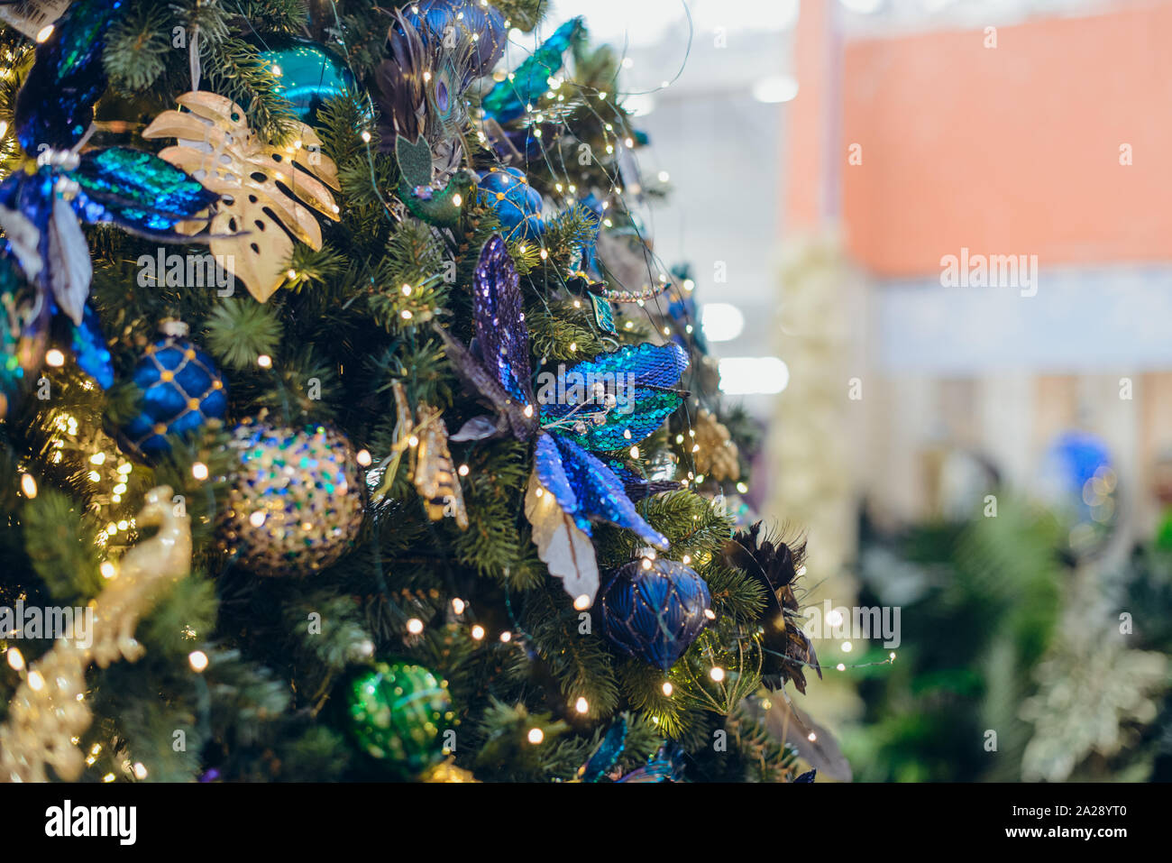 Close Up Creative Modern Christmas Tree Decor Golden Tropical Monstera Leaves Navy Blue Shiny Flowers And Balls With Garland Lights Exotic New Year Stock Photo Alamy