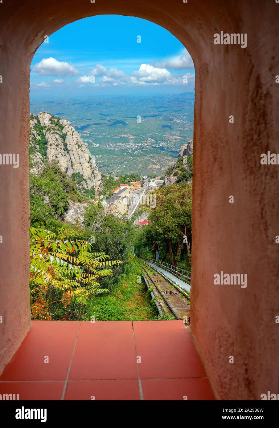 Picturesque view through window on famous monastery Santa Maria de Montserrat located in mountains. Catalonia, Spain Stock Photo