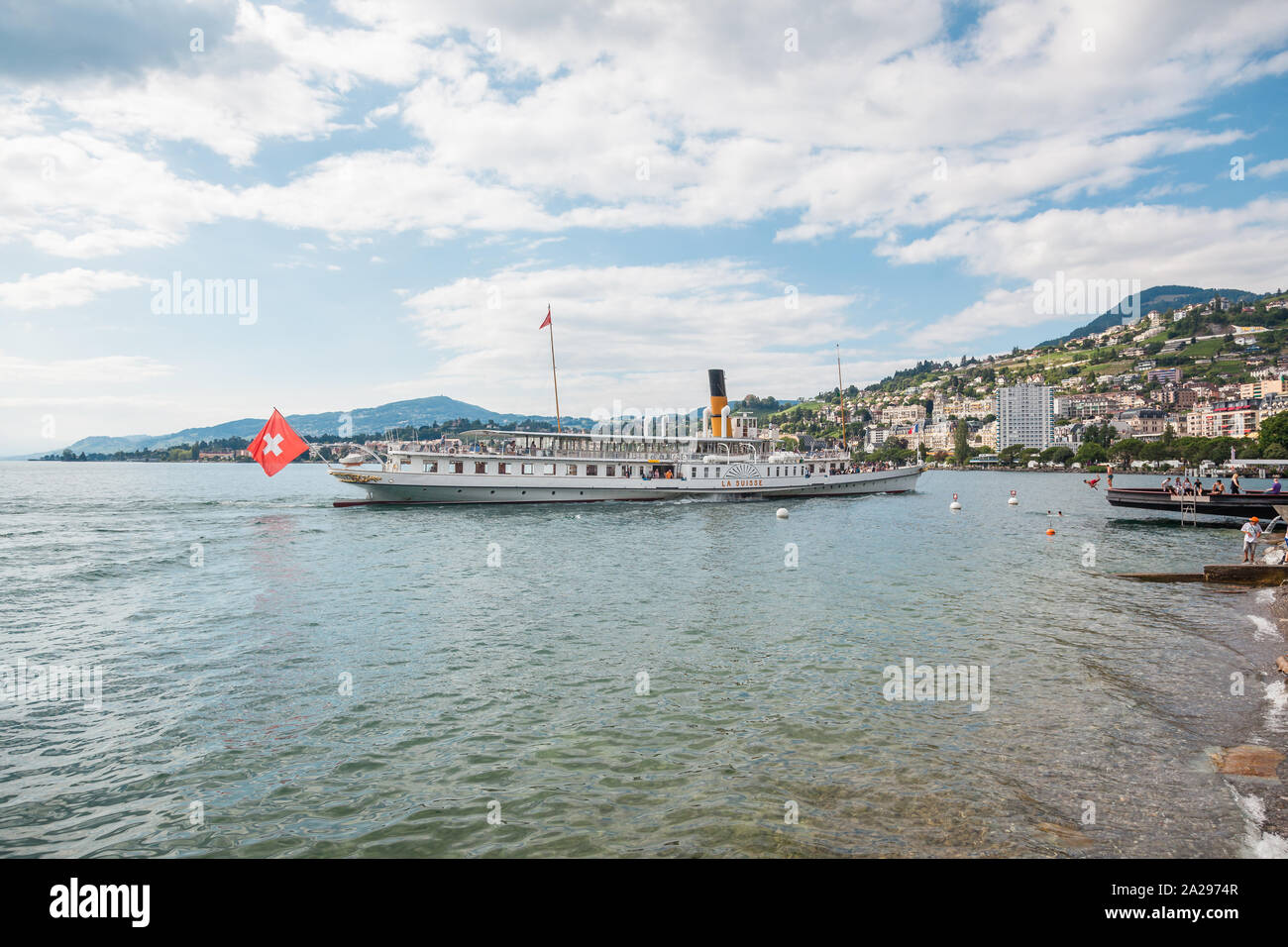 The most beautiful  steam boat called La Suisse approaching Montreux pier on Swiss Riviera, Vaud, Switzerland on summer day Stock Photo
