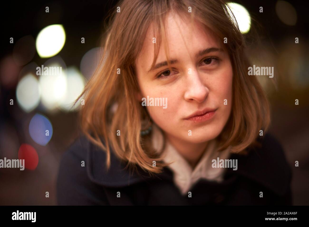 portrait of woman at night in Berlin, Germany Stock Photo