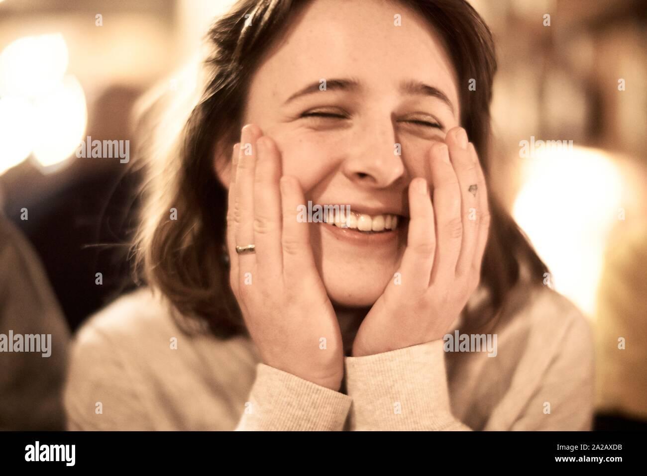 headshot of happy woman indoors in restaurant Stock Photo