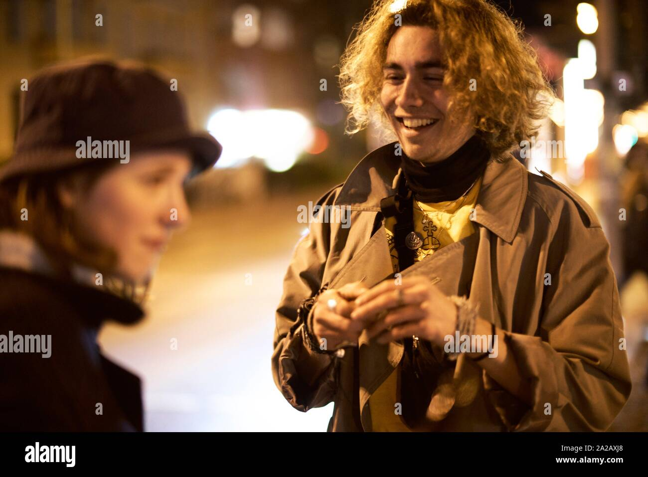 Young couple on the street, nightlife, in Berlin, Germany. Stock Photo