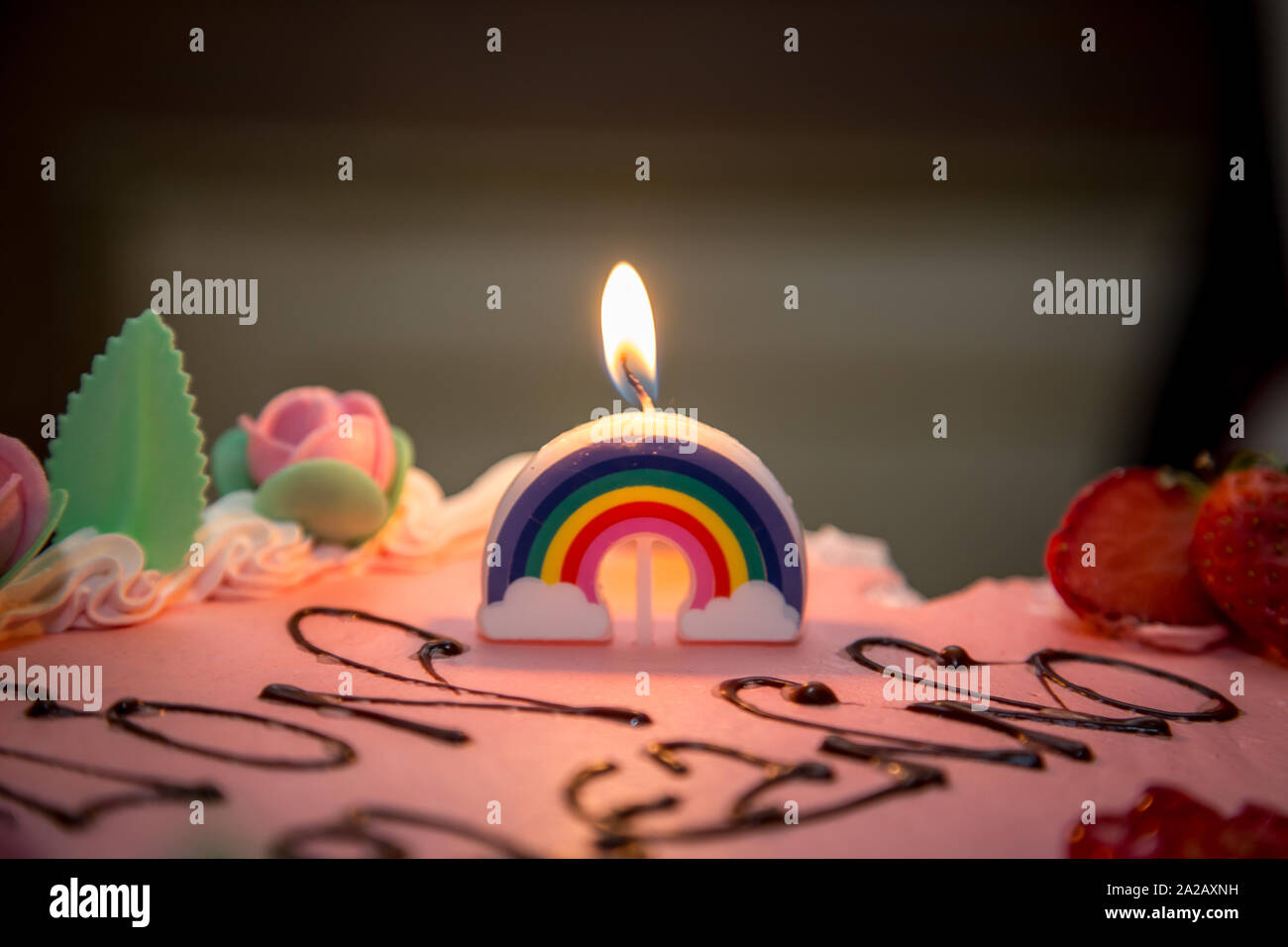 Superb Rainbow Candle On The First Birthday Cake Girl Stock Photo Personalised Birthday Cards Cominlily Jamesorg