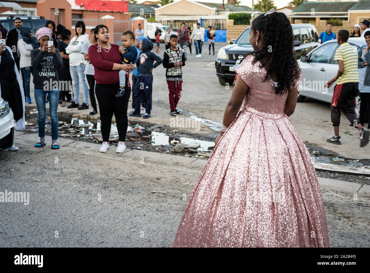 A young girl poses for photographs before attending her school matric dance in South Africa's gang-ridden Cape Town neighbourhood of Hanover Park Stock Photo
