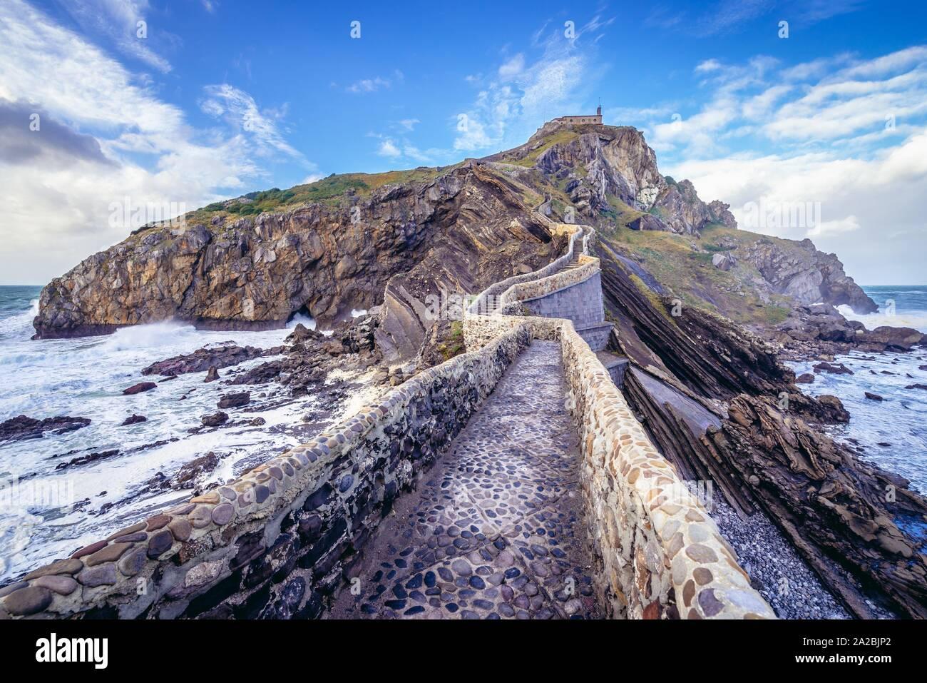 Bridge to hermitage on Gaztelugatxe islet in on the coast of Biscay province of Spain. Stock Photo
