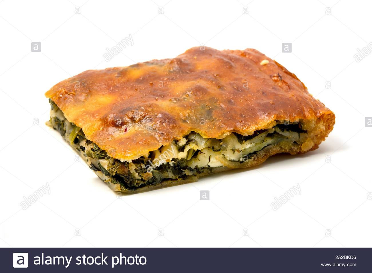 Typical Borek with a spinach and cheese filling on a white background. Stock Photo