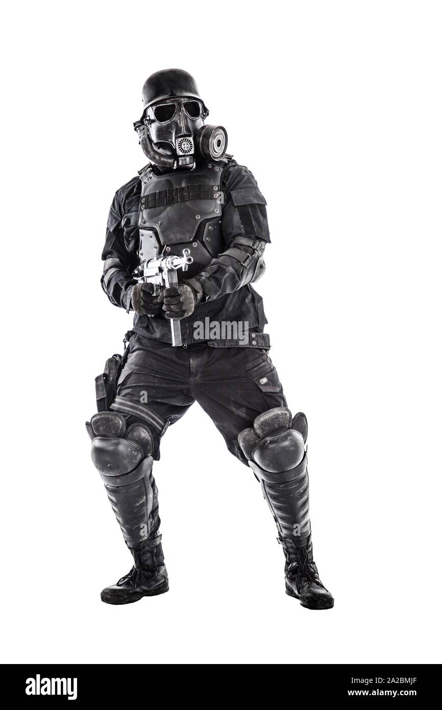Futuristic nazi soldier gas mask and steel helmet with schmeisser handgun isolated on white studio shot full body portrait. Stock Photo