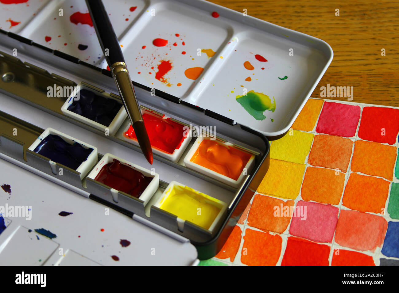 Watercolor pallet and a color mixing study Stock Photo