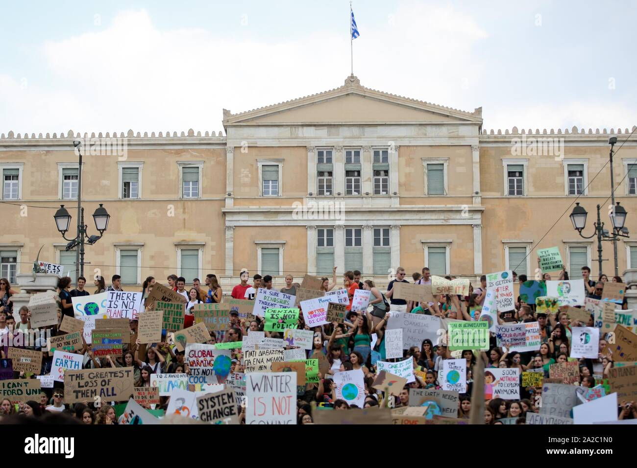 Climate protesters demonstrate in the center of Athens. Protesters around the world joined rallies on Friday as a day of worldwide demonstrations calling for action against climate change began ahead of a U.N. summit in New York. Stock Photo