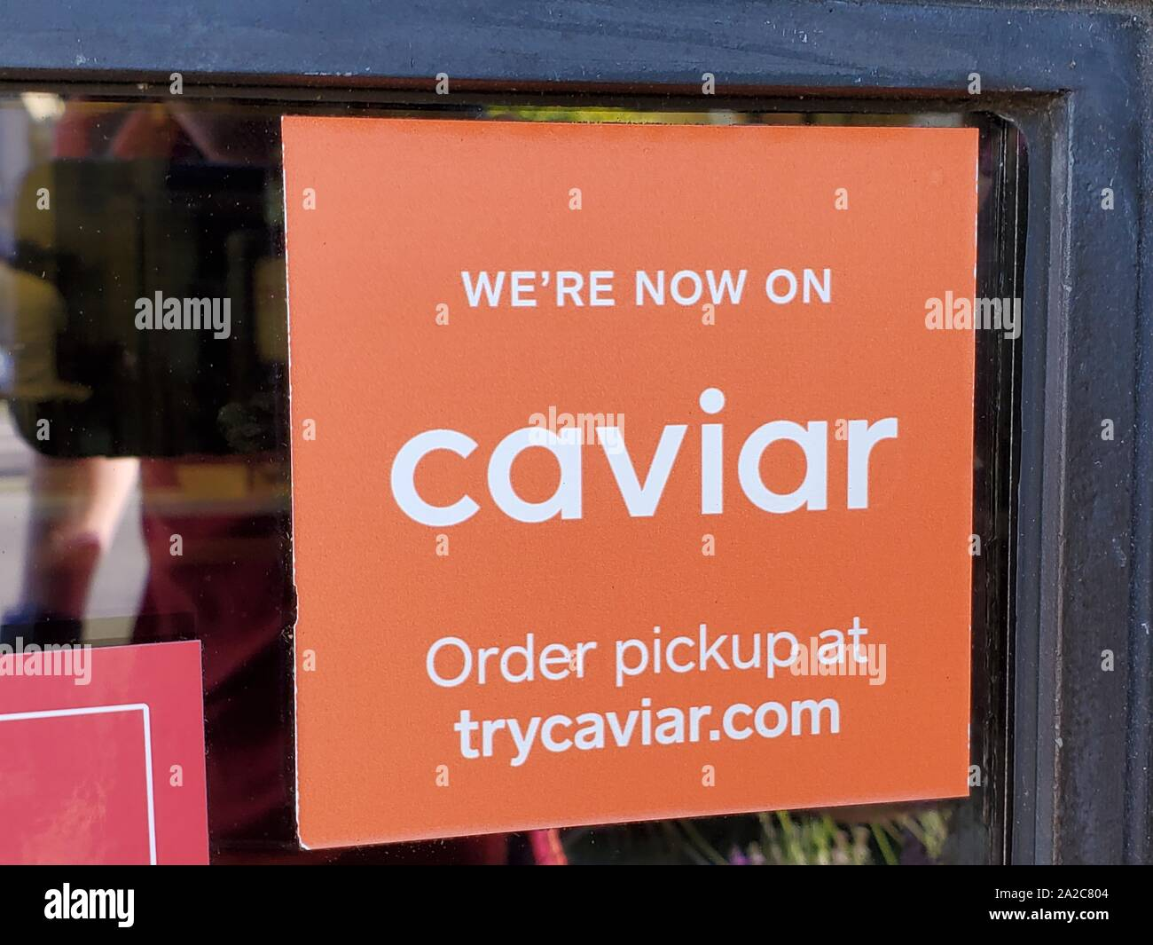 Close-up of logo for food delivery technology company Caviar at a participating restaurant in Walnut Creek, California, following the company's announcement that it would be acquired by delivery service Doordash, August 2, 2019. () Stock Photo
