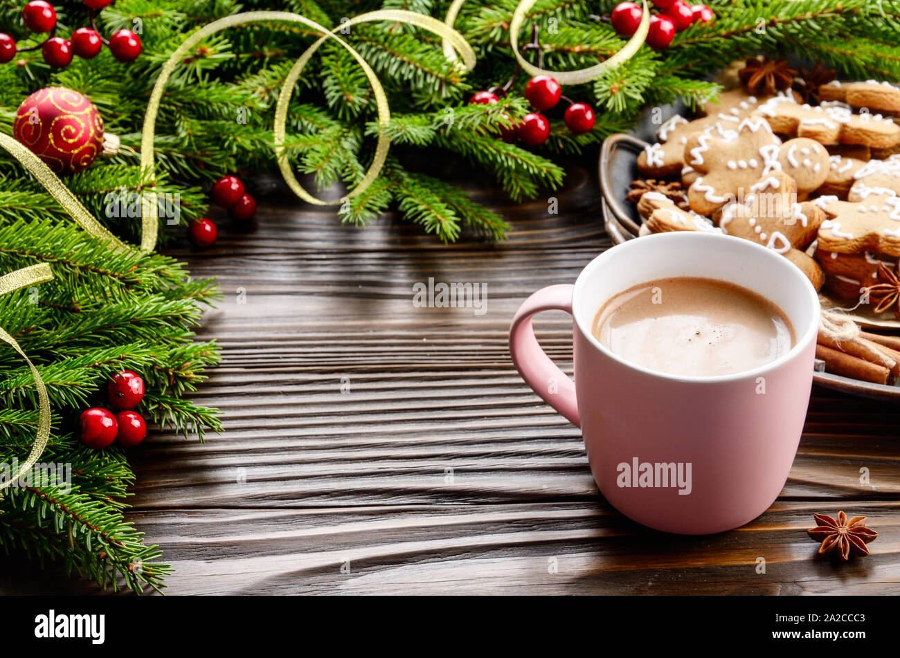 Christmas Background Of Pink Mug With Hot Chocolate Spruce Branch And Tray With Gingerbread Man Cookies On Wooden Table Stock Photo Alamy