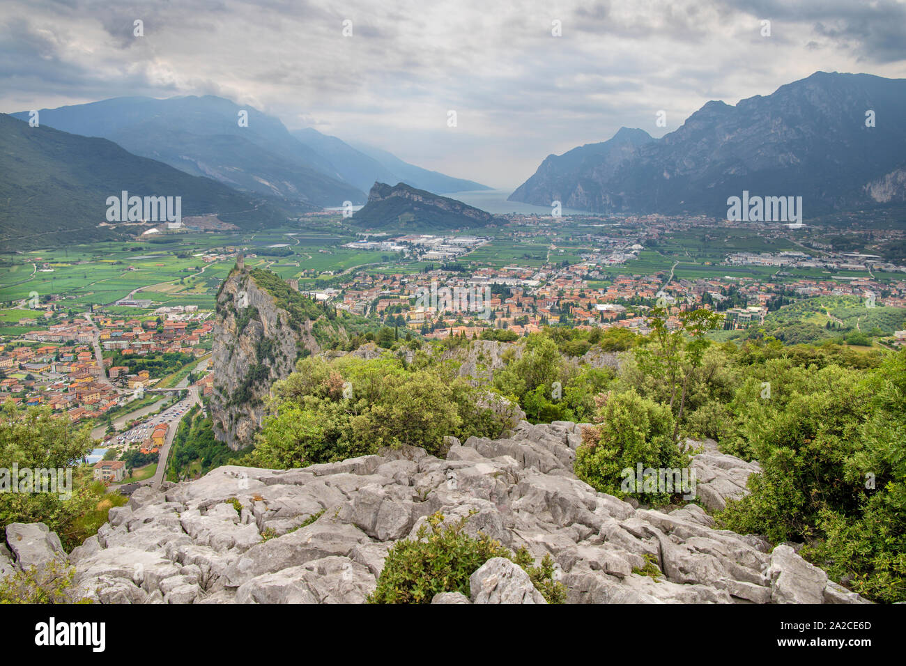 Arco - The Town with the medieval castle, alps and lake in the background. Stock Photo