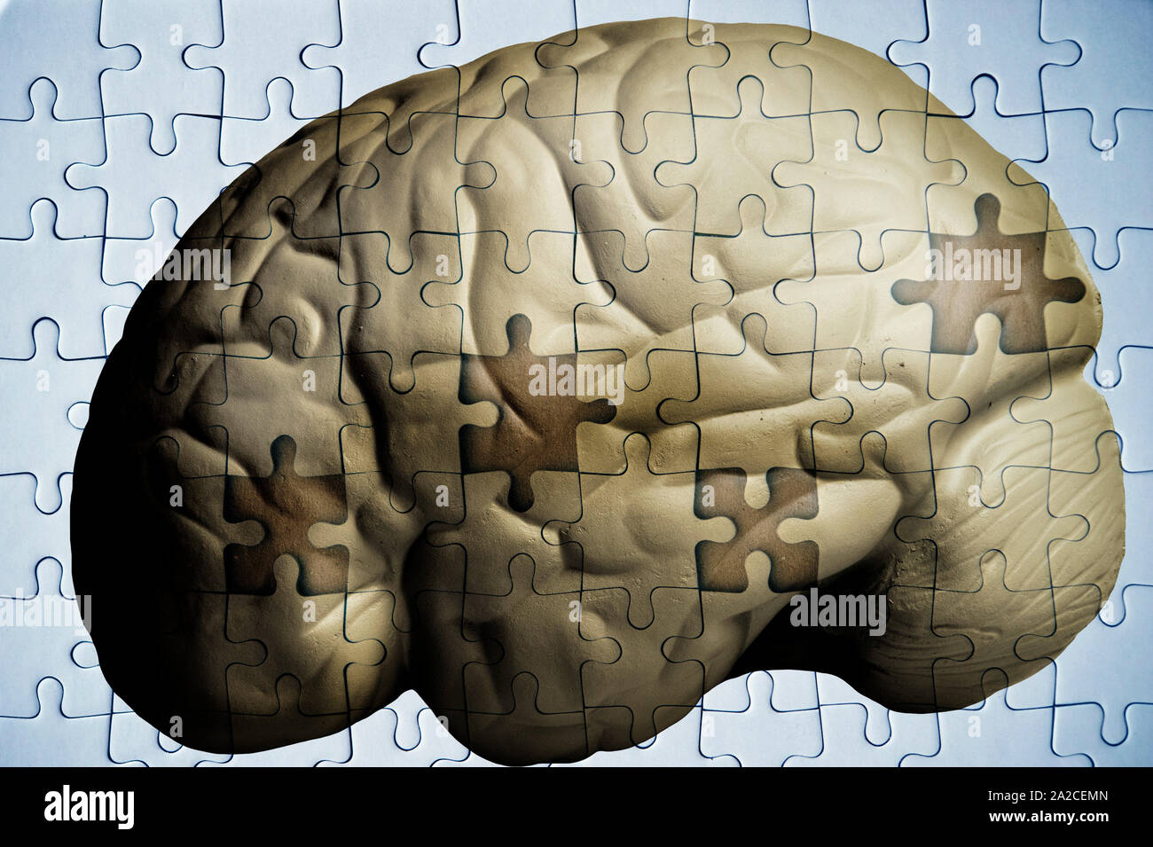 human brain and jigsaw puzzle with missing pieces - Alzheimer Stock Photo