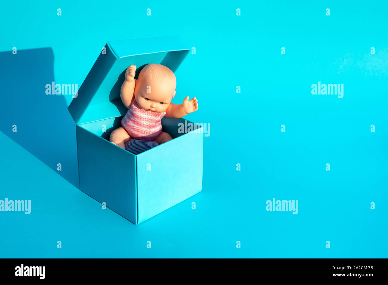 Baby Child Inside Cute Box On Blue Color Background Surprise And