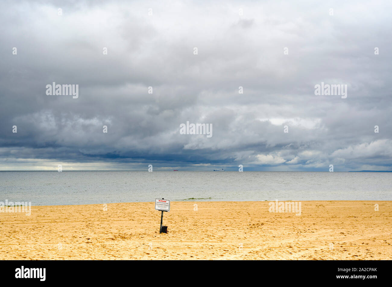 Bansin, Germany - September 13, 2019: Lonely beach on Usedom with view over the sea to dramatic looking storm clouds. Stock Photo