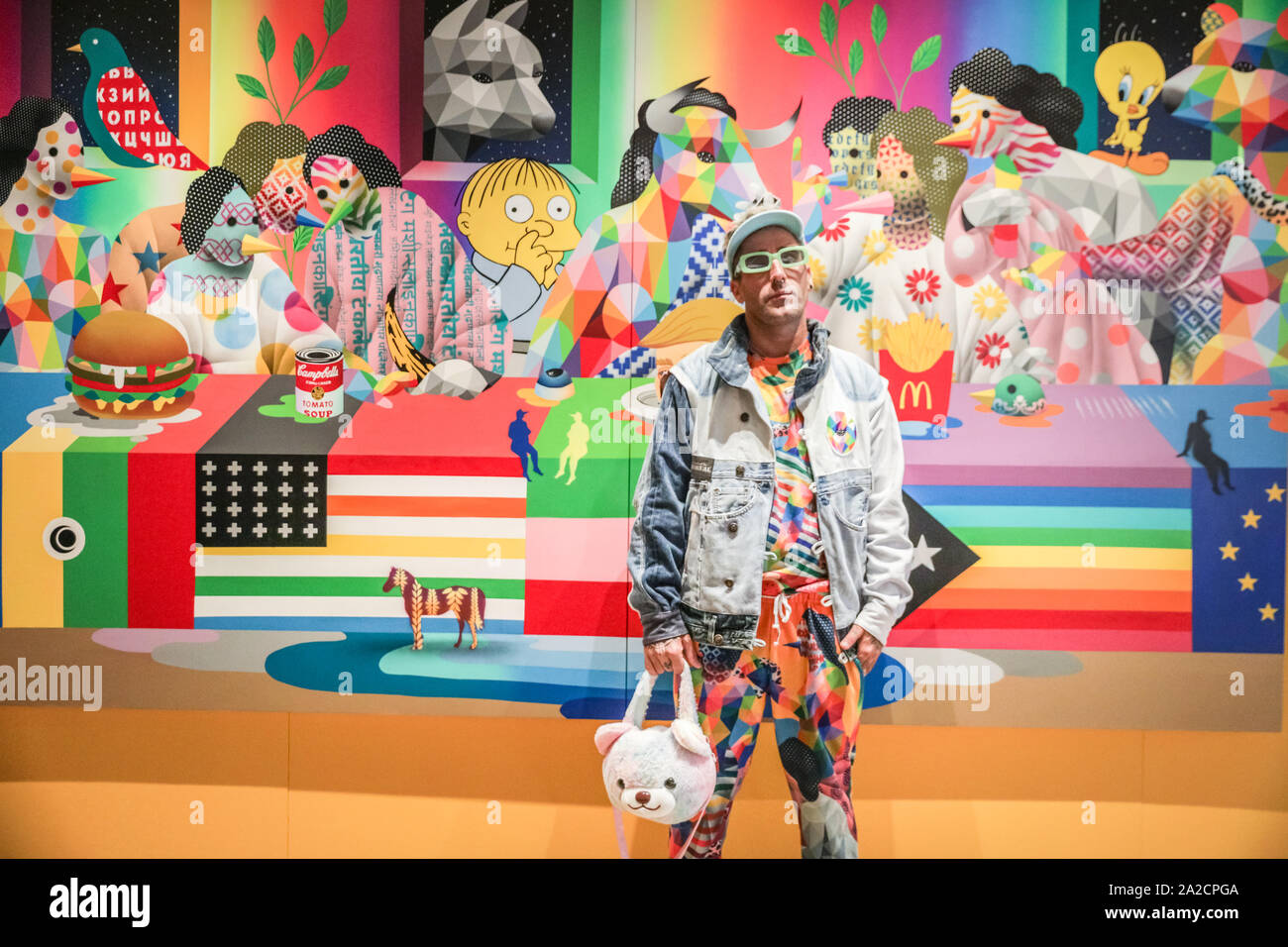 Chelsea Sorting Office, London, UK, 02 Oct 2019. Artist Okuda San Miguel with his work entitled 'The Last Supper II'. The 10th anniversary installation halls of Moniker Art Fair see the best of British urban artists, featuring a stellar roster of creatives, including acclaimed international artists making their UK debuts and Moniker's own Spotlight Artists of 2019. Credit: Imageplotter/Alamy Live News Stock Photo