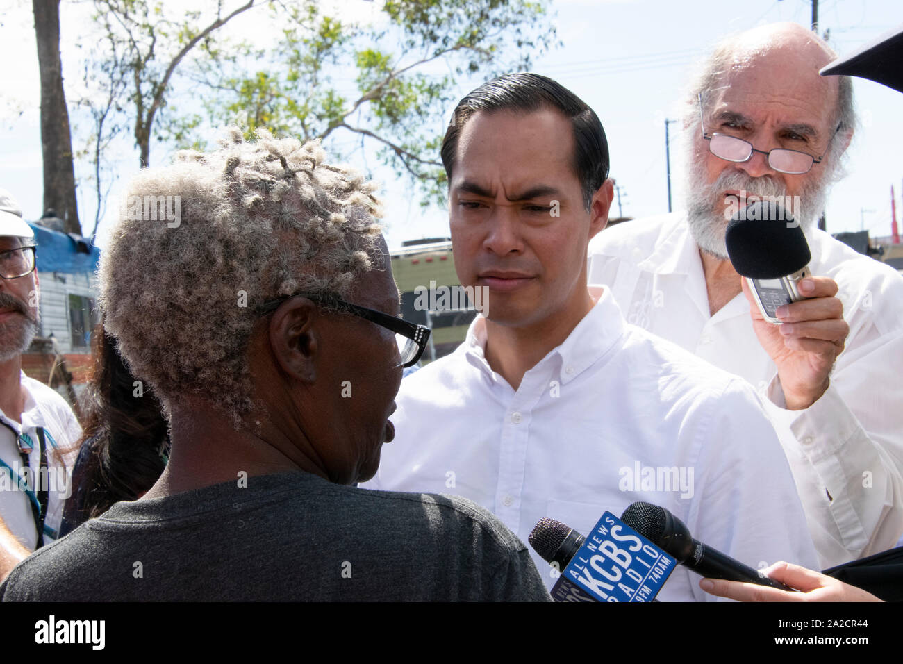 Democratic Presidential Candidate Julián Castro speaks to Elizabeth Easton, a resident of an Oakland homeless encampment, on Sept. 25. Stock Photo