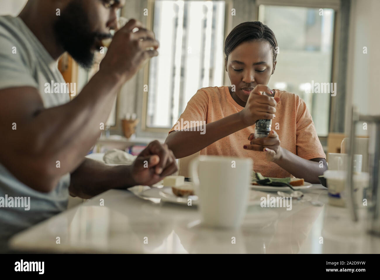 Young African American couple sitting at home having breakfast Stock Photo
