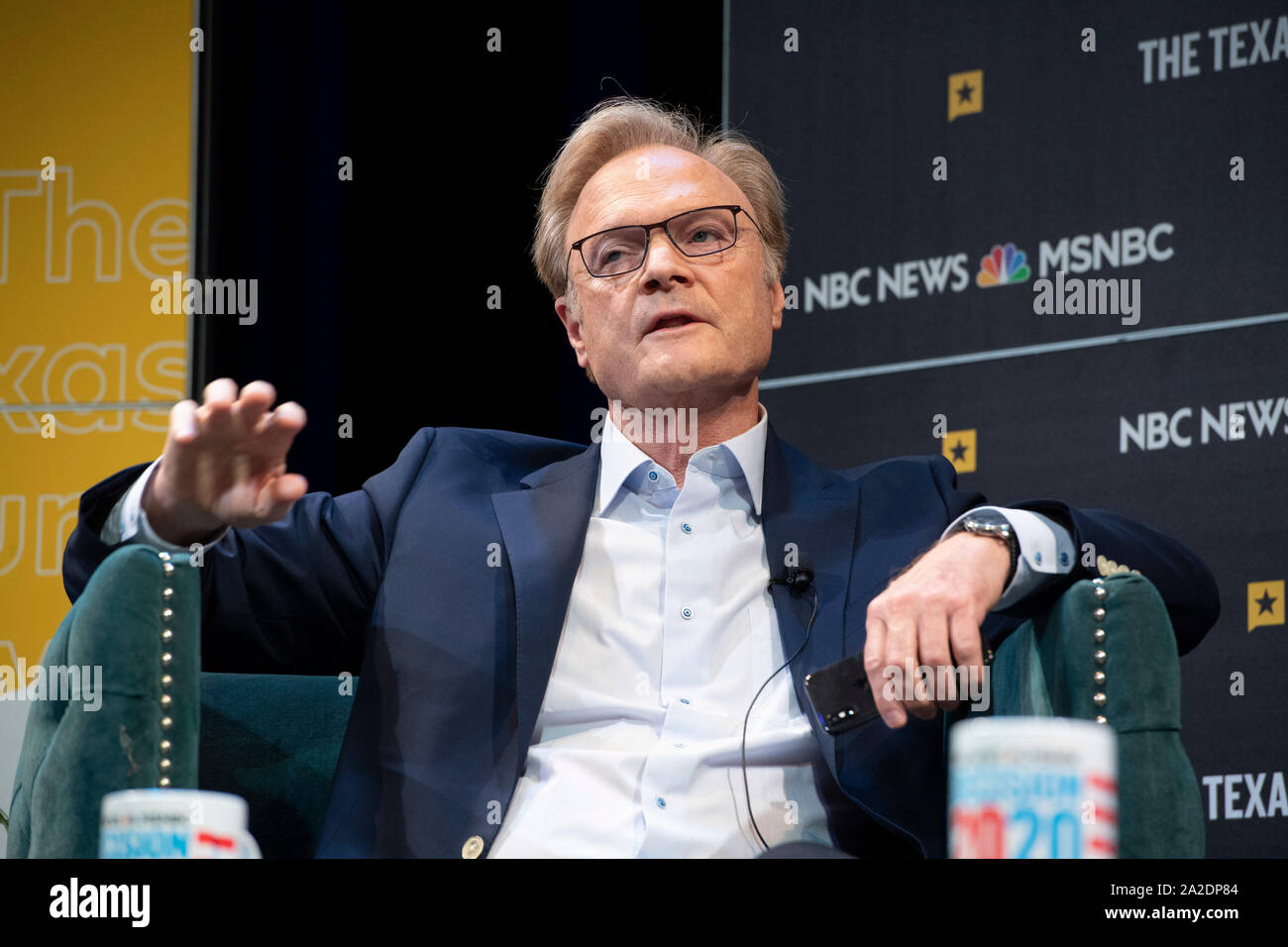 MSNBC political commentator Lawrence O'Donnell gestures while interviewing U.S. Sen. Michael Bennet of Colorado during a Texas Tribune Festival session. Stock Photo