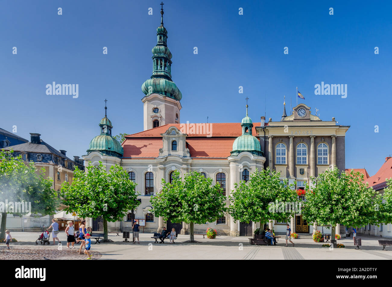 Pszczyna (ger.: Pless), Silesian province, Poland. Lutheran church and the town hall, Marketplace square. Stock Photo