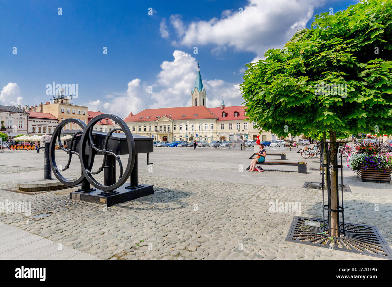 Oswiecim (ger.: Auschwitz), Lesser Poland province.  Old well with reconstructed water pump, Main Market square. Stock Photo