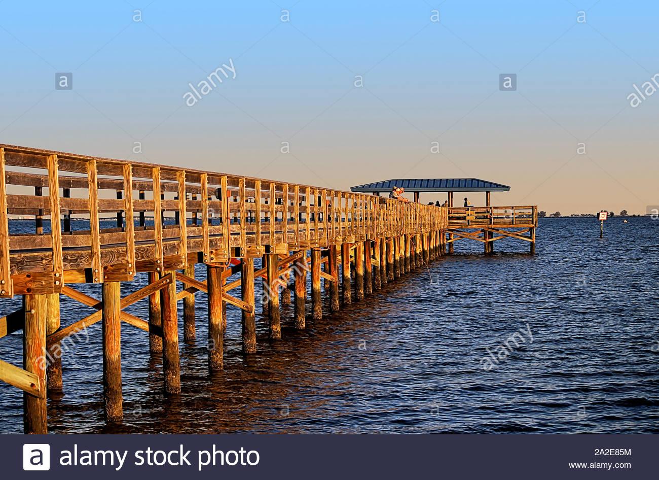 Marina Park Fishing Pier. Boardwalk located south of Safety Harbor, facing Tampa Bay. Photo taken at sunset Stock Photo