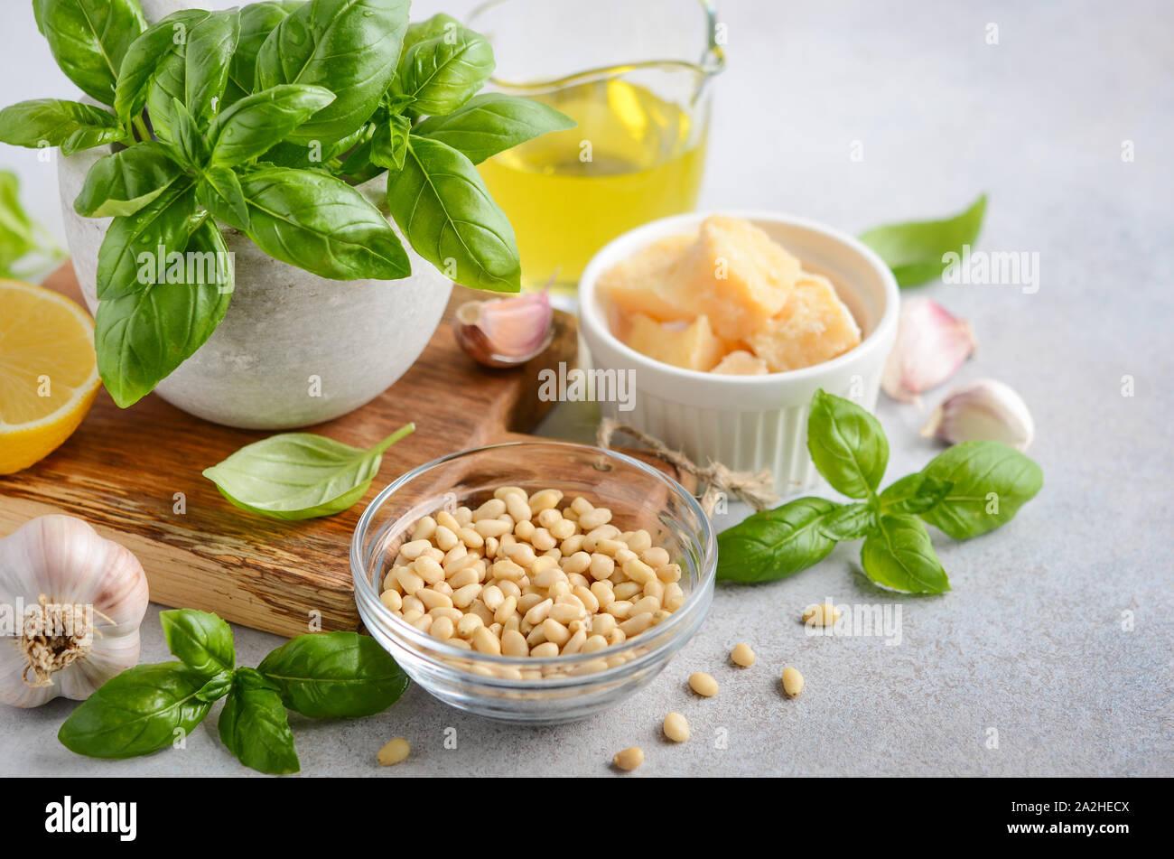 Ingredients for making green pesto sauce. Stock Photo