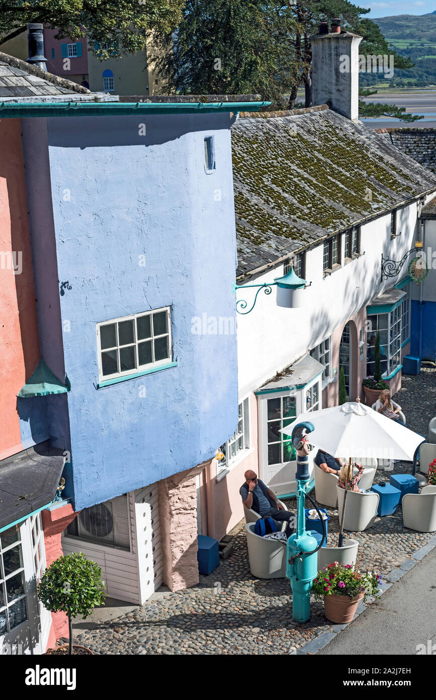 Visitors enjoying the colourful and unique village architecture at Portmeirion Village, Wales UK on a sunny day. Stock Photo