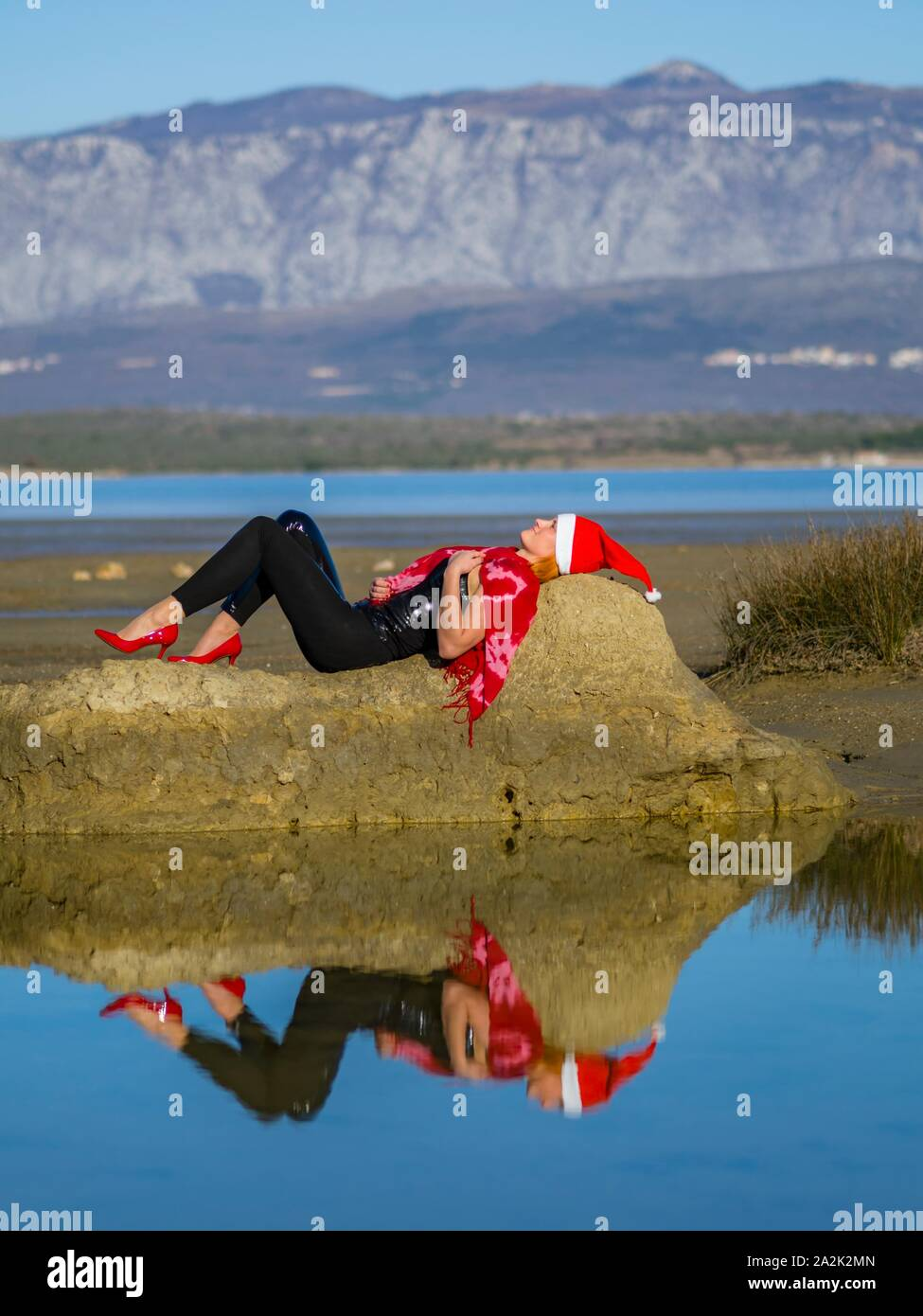 Resting female Santa Stock Photo