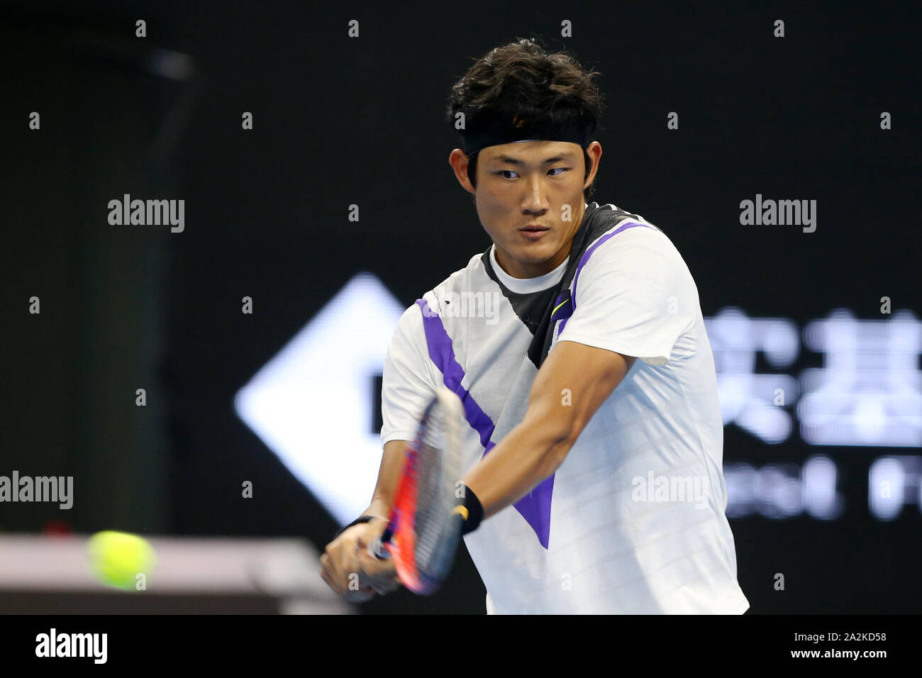 Chinese professional tennis player Zhang Zhizhen competes against Austrian professional tennis player Dominic Thiem at the second round of 2019 China Open (Tennis), in Beijing, China, 2 October 2019. Chinese professional tennis player Zhang Zhizhen was defeated by Austrian professional tennis player Dominic Thiem with 0-2 at the second round of 2019 China Open (Tennis), in Beijing, China, 2 October 2019. Stock Photo