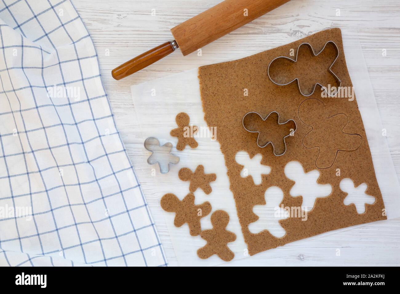 Homemade raw dough for cooking Christmas cookies on a white wooden background, top view. Flat lay, overhead, from above. Stock Photo
