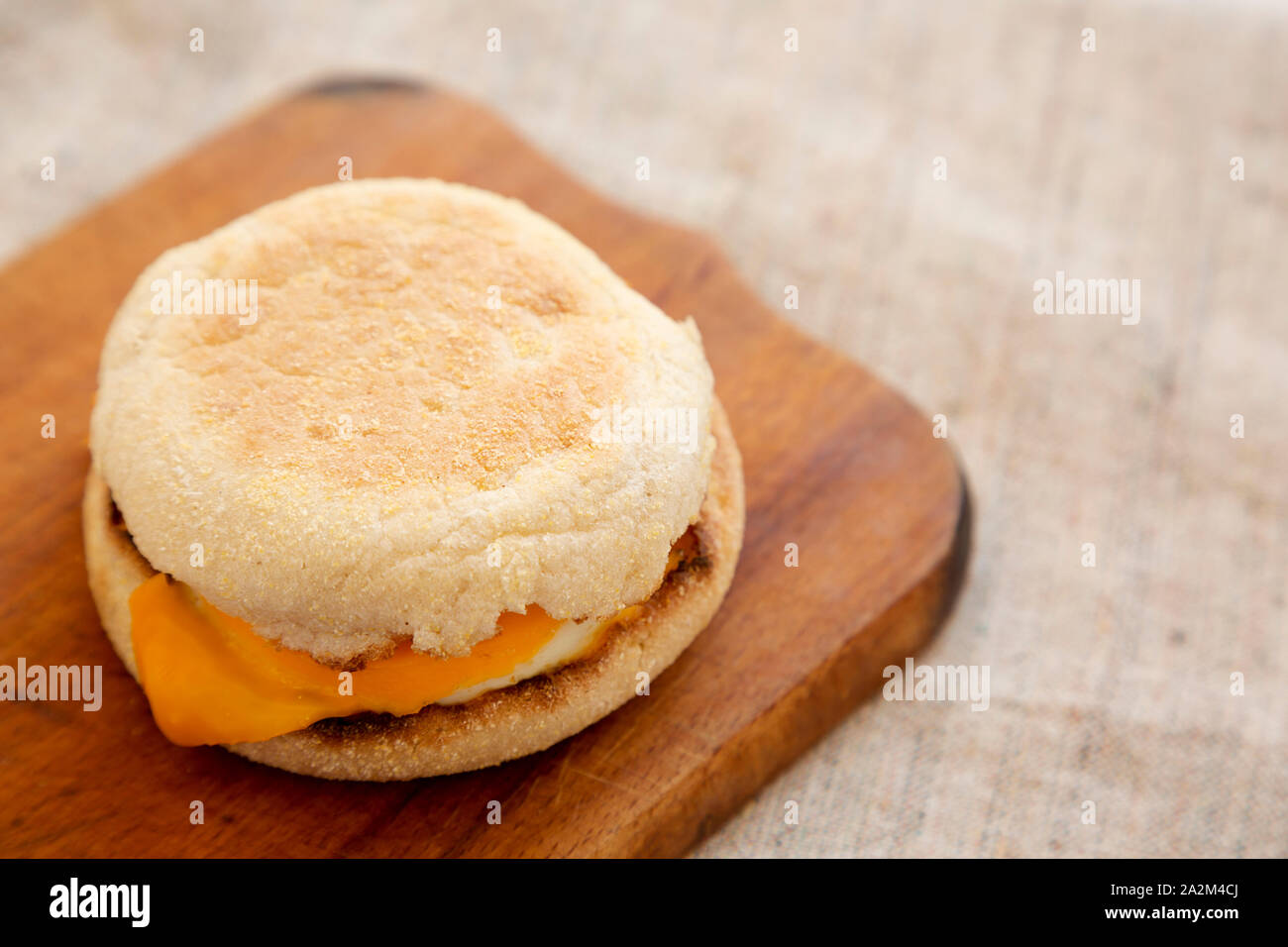 Homemade egg sandwich with cheese on a rustic wooden board, low angle view. Copy space. Stock Photo