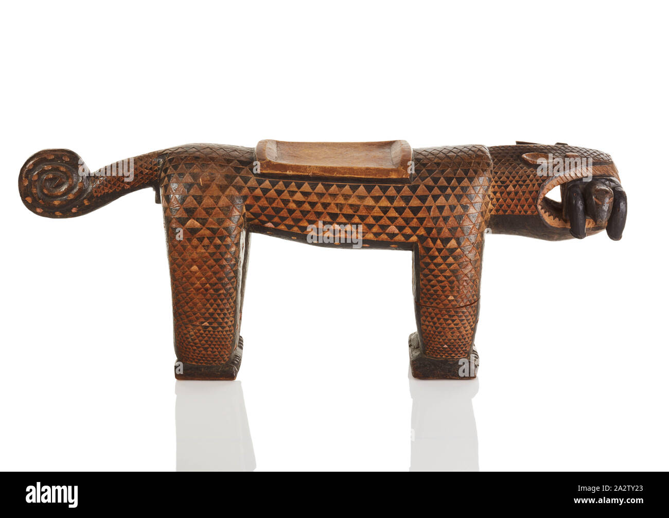 stool in the form of a leopard, Baule people, 20th century, wood, pigment, 18-1/2 x 14-3/4 x 12 in., African Art Stock Photo
