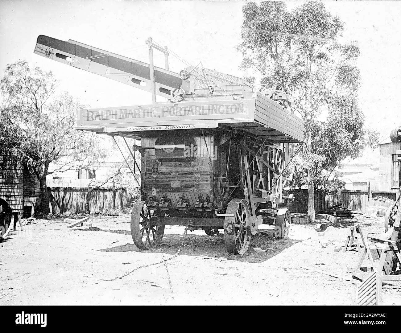 Negative - Threshing Machine, Ralph Martin, Portarlington, Victoria, circa 1915, Travelling threshing machine of contractor Ralph Martin, Portarlington, Victoria. The threshing machine is fitted with a patent sheaf elevator and feeder labelled P.W. Sides' Patent, No.19746/10. No.3, Sawmill, ???, Geelong Stock Photo