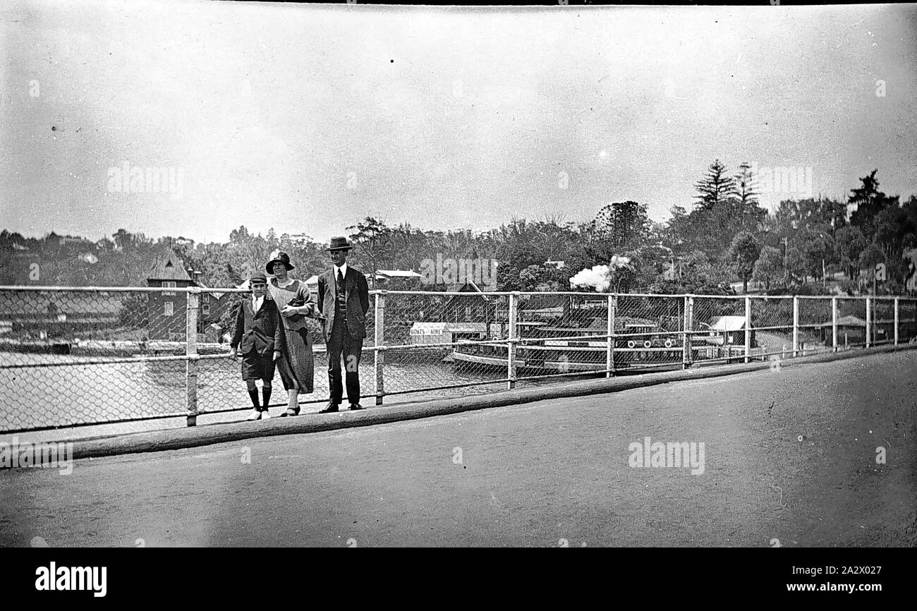 Negative - Lane Cove, New South Wales, circa 1930, The Henshaw family pictured on a bridge at Lane Cove, a Sydney Harbour ferry in the background Stock Photo