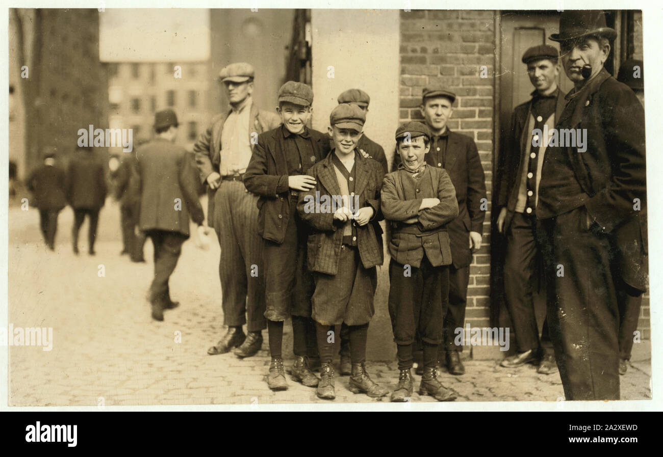 Robert Magee (smallest). 270 Suffolk St., Apparently 12 years old Been working in Mule Room #1, Merrimac Mill, Lowell, 1 year. Michael Keefe (next in size), 32 Marion St., been working in #1 Mule Room, Merrimac Mill, Lowell, for 8 months, about 13 or 14. Cornelius Hurley, 298 Adams St., been at work in #1 Mule Room, Merimac Mill, Lowell, for 6 months, about 13 or 14. Stock Photo