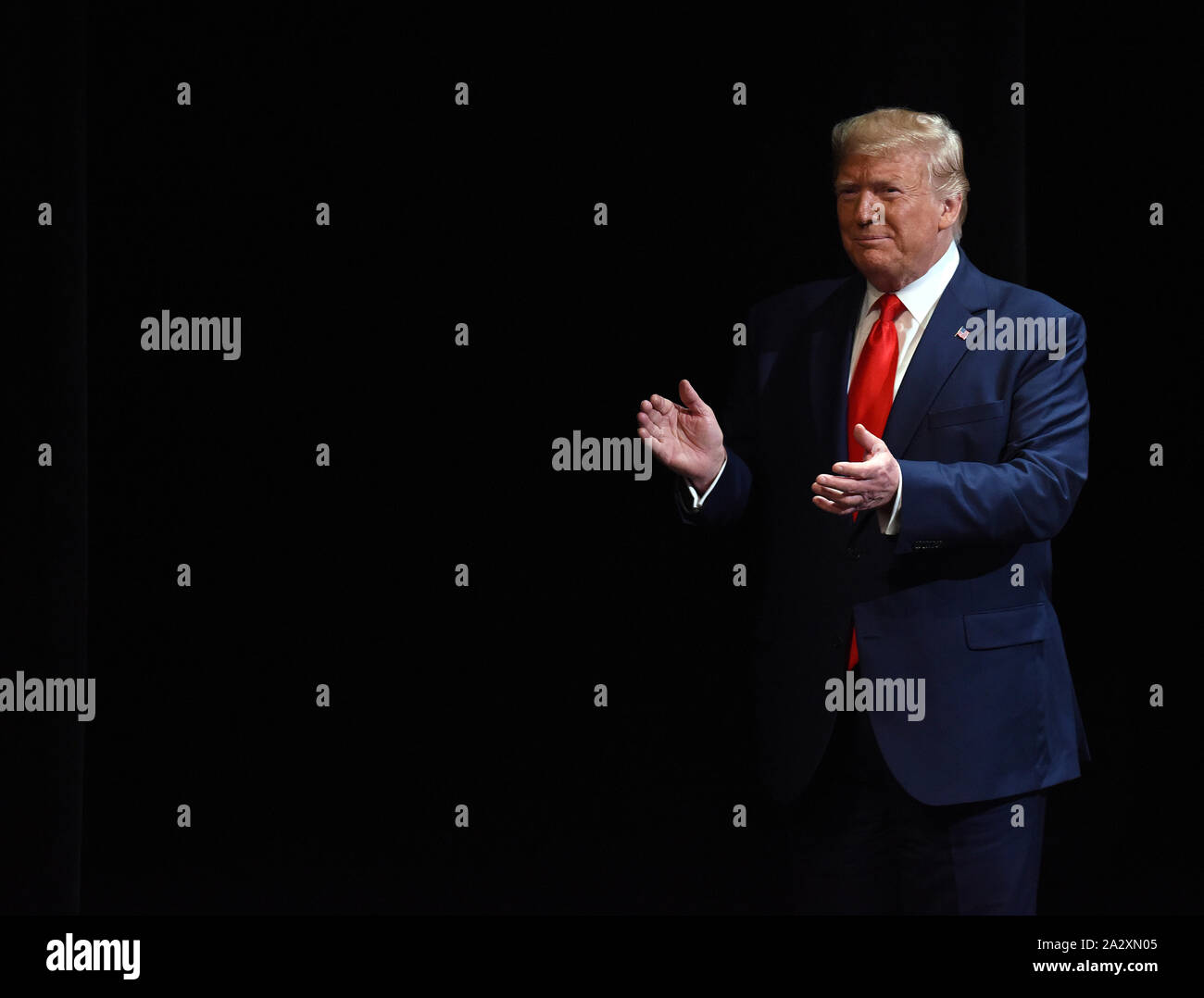 The Villages, United States. 03rd Oct, 2019. U.S. President Donald Trump looks claps his hands after giving remarks on his administration's health policy and signing an executive order regarding Medicare at the Sharon L. Morse Performing Arts Center on October 3, 2019 in The Villages, Florida. Credit: Paul Hennessy/Alamy Live News Stock Photo