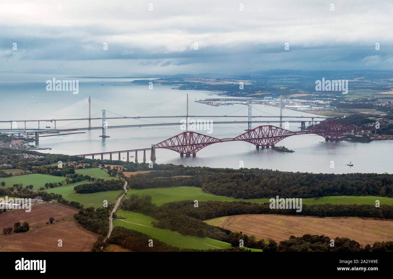 Aerial view of the three bridges that span the Firth of Forth between South and North Queensferry, Scotland. Stock Photo