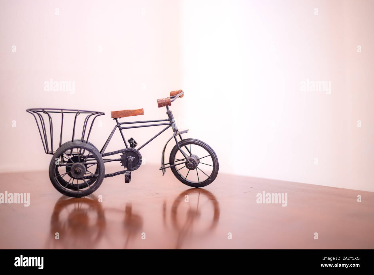 Toy bicycle or Indian style rickshaw isolated on a pink background Stock Photo