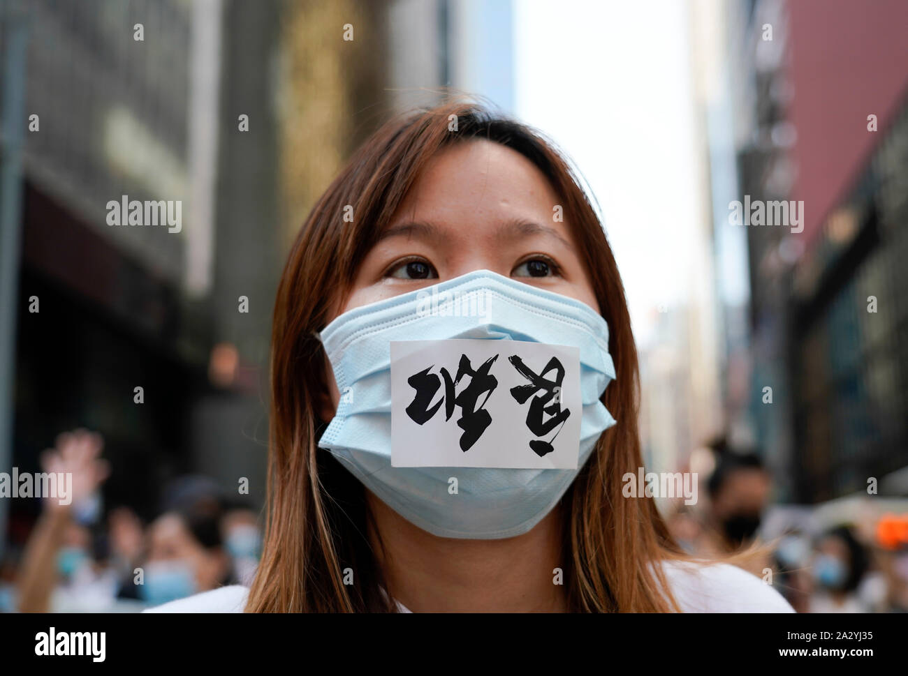 Hong Kong. 4 October 2019. Large peaceful march by thousands of pro-democracy supporters through Central business district of Hong Kong this afternoon. March was in protest against Chief Executive Carrie Lam's use of Emergency Powers to ban the wearing of masks during protests. Iain Masterton/Alamy Live News. Stock Photo