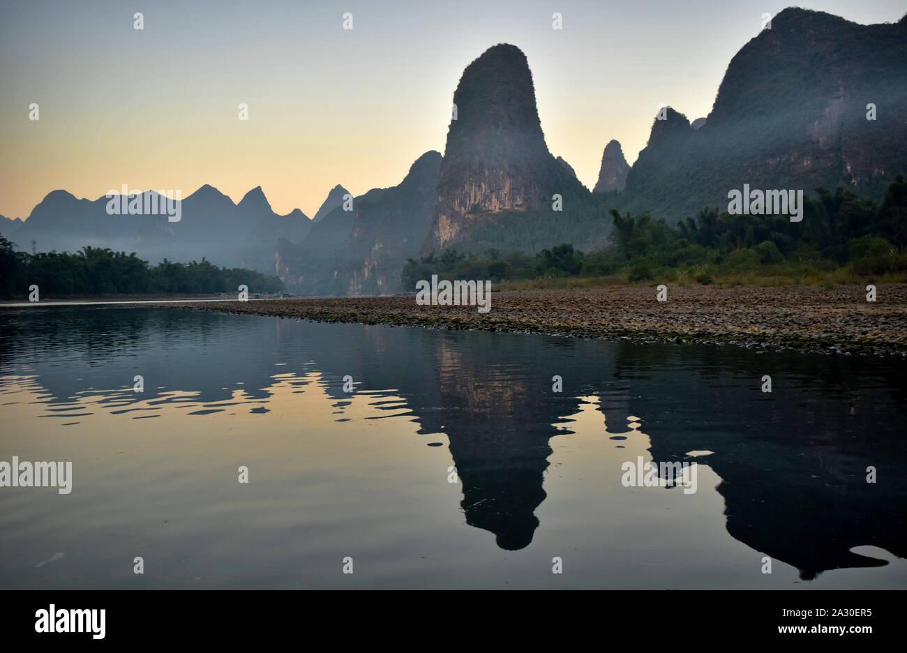 Li river basin and mountains at dusk, Guangxi, China Stock Photo