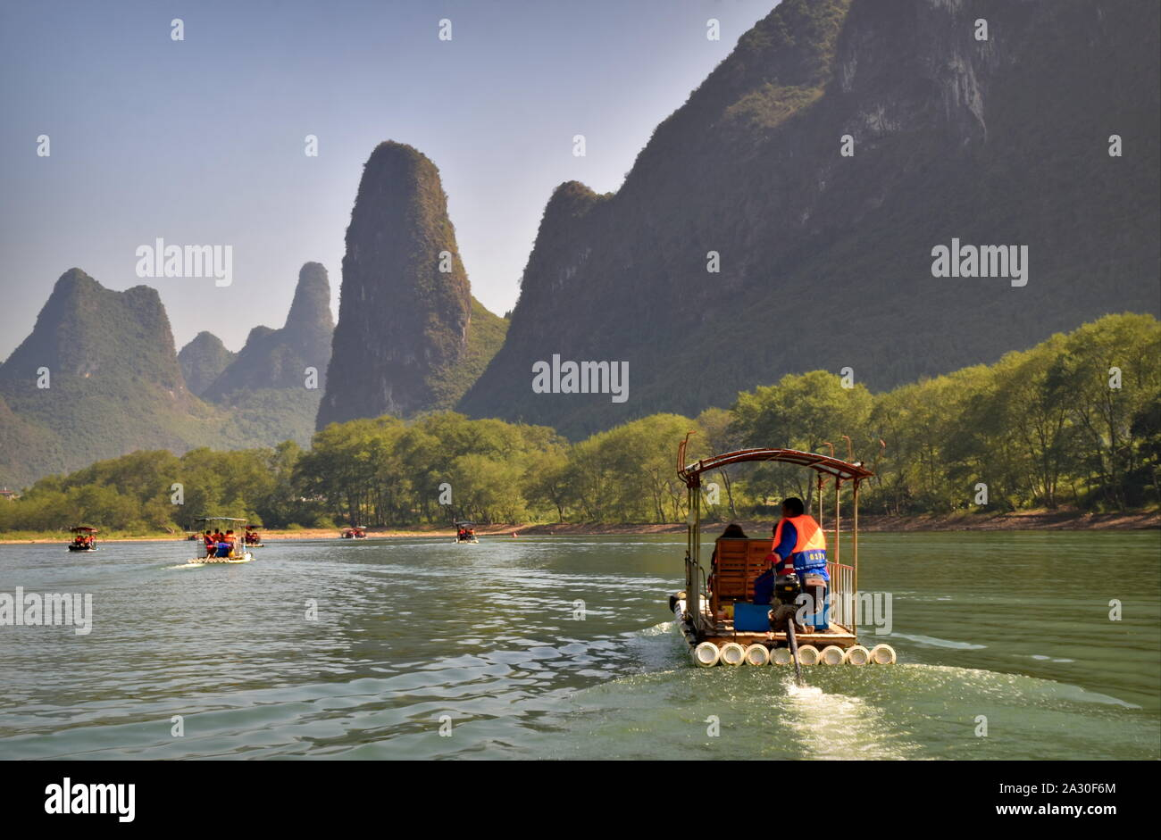 Li river bamboo raft boats and beautiful green mountain peaks - Guilin, China Stock Photo