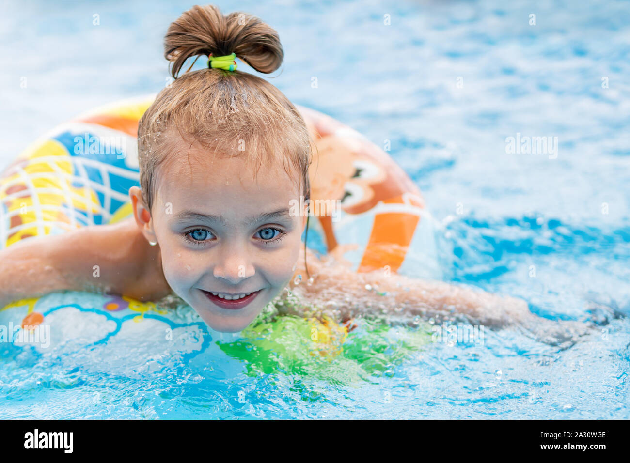 child floats on an inflatable ring Stock Photo
