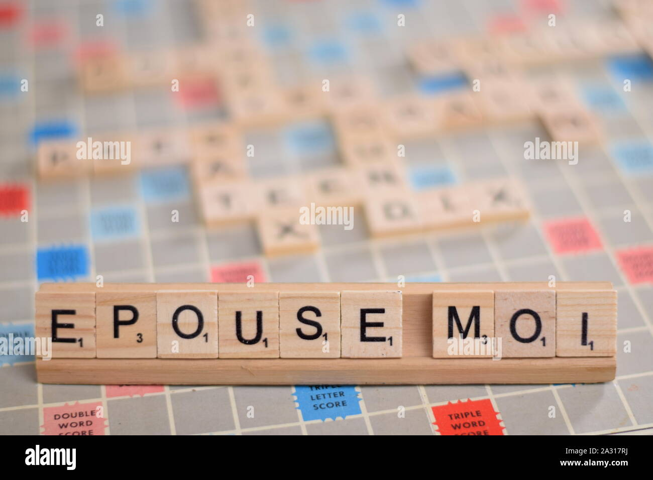 The French Word Epouse Moi In English Marry Me In Wooden Scrabble Tiles On A Rack The Background A Vintage Board Out Of Focus Copy Space Stock Photo Alamy