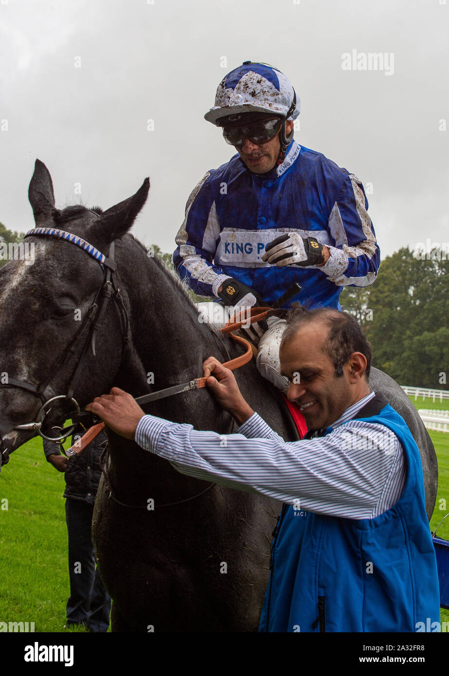 Autumn Racing Weekend & Ascot Beer Festival, Ascot Racecourse, Ascot, Berkshire, UK. 4th October, 2019. Jockey Silvestre De Sousa is splashed with mud during the Mar-Key Group Classified Stakes riding horse Fox Leicester.  Credit: Maureen McLean/Alamy Stock Photo