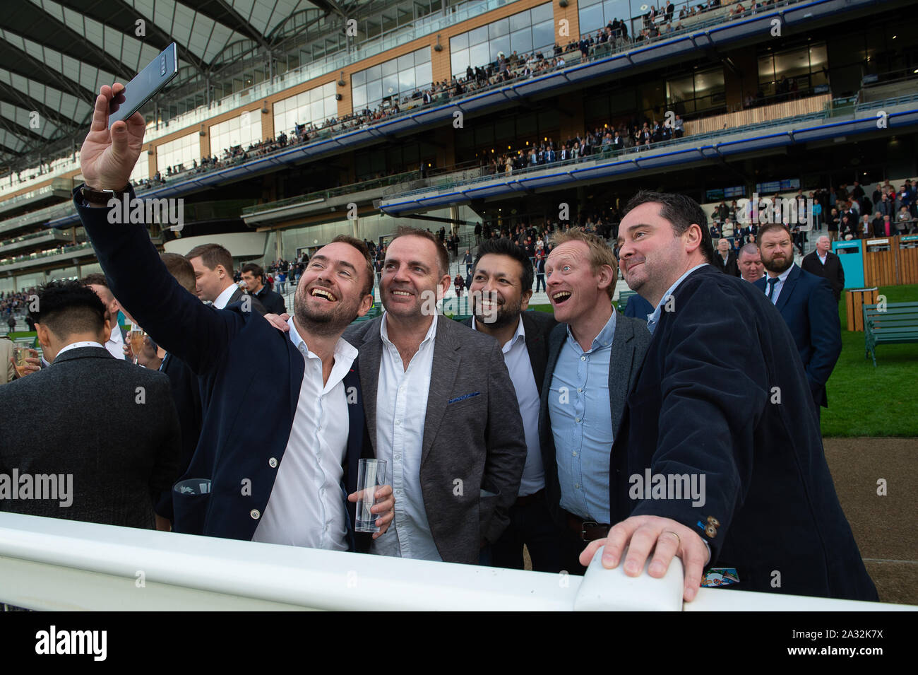 Autumn Racing Weekend & Ascot Beer Festival, Ascot Racecourse, Ascot, Berkshire, UK. 4th October, 2019. Selfie time for these men at the races. Credit: Maureen McLean/Alamy Stock Photo