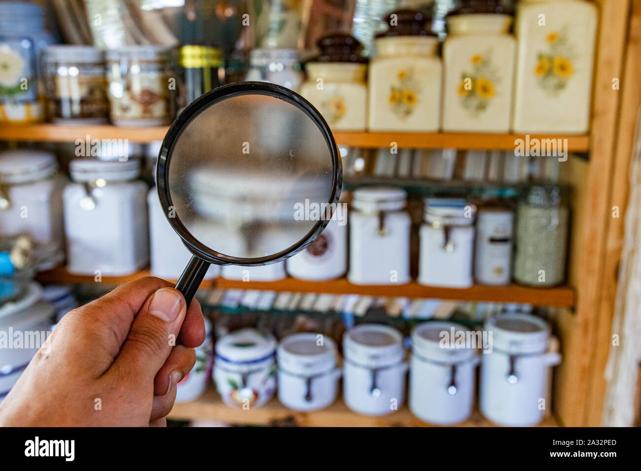 Looking For Signs Of Damp And Mold Inside The Kitchen Pantry With A Magnifying Glass Blurred Storage Jars Are Seen Displayed On Vintage Wooden Shelves Stock Photo Alamy